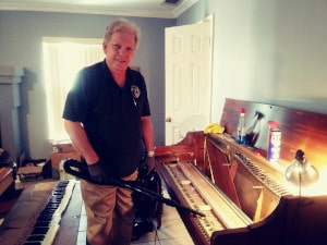 Len Hess Cleaning A Piano